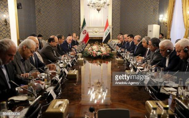 Iran's First Vice President Eshaq Jahangiri and Iraqi Prime Minister Haider alAbadi attend interdelegations meeting in Tehran Iran on October 26 2017