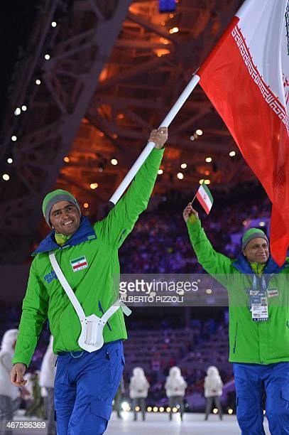 Iran's flag bearer alpine skier Hossein SavehShemshaki leads his national delegation during the Opening Ceremony of the Sochi Winter Olympics at the...