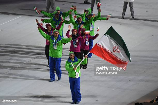 Iran's flag bearer alpine skier Hossein SavehShemshaki leads his delegation during the Opening Ceremony of the Sochi Winter Olympics at the Fisht...