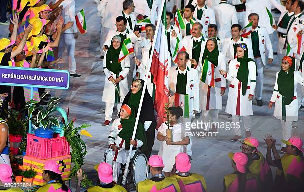 Iran's flag bearer Zahra Nemati leads her national delegation during the opening ceremony of the Rio 2016 Olympic Games at the Maracana stadium in...