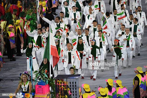 Iran's flagbearer Zahra Nemati leads her delegation during the opening ceremony of the Rio 2016 Olympic Games at the Maracana stadium in Rio de...