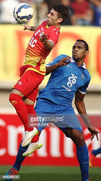 Iran's Foolad midfielder, Esmaeil Sharifat fights for the ball with Saudi Arabia's al-Hilal defender Digao during the AFC champions league Group C...
