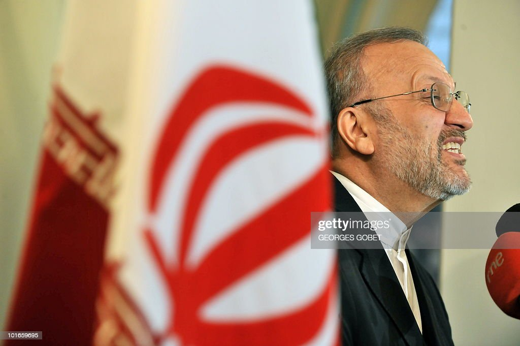 Iran's Foreign Minister Manouchehr Mottaki grimaces as he answers to journalists' questions on June 2, 2010 during a press conference at the Iranian embassy in Brussels. Mottaki warned that 'Fresh international sanctions against Iran over its nuclear programme could lead to confrontation' and denounced European 'intolerance' towards the Islamic veil, as France and Belgium move towards banning the burqa in public.