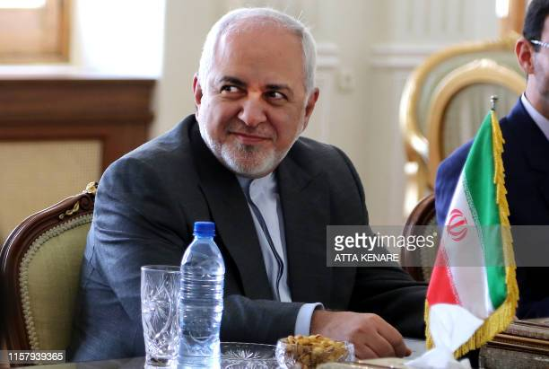 Iran's Foreign Minister Mohammad Javad Zarif attends a meeting with Oman's Minister of State for Foreign Affairs Yousuf bin Alawi bin Abdullah in...
