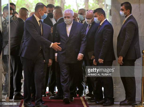 Iran's Foreign Minister Mohammad Javad Zarif is welcomed upon his arrival for his meeting with his Iraqi counterpart in Iraq's capital Baghdad on...