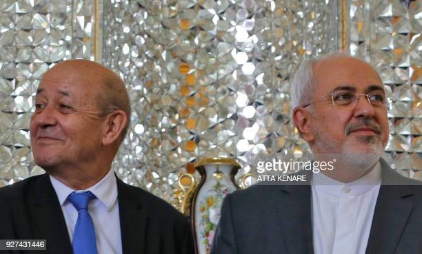 Iran's Foreign Minister Mohammad Javad Zarif shakes hands with French Foreign Minister JeanYves Le Drian as they meet in the capital Tehran on March...