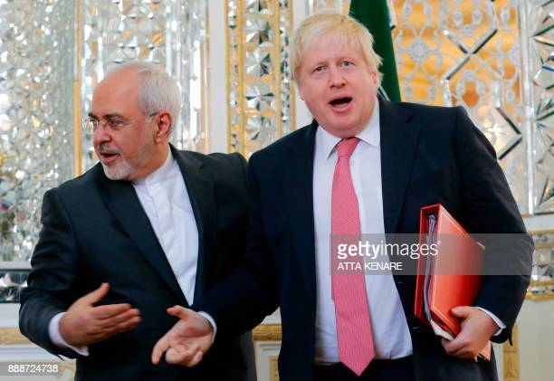 Iran's Foreign Minister Mohammad Javad Zarif shakes hands with his British counterpart Boris Johnson during a meeting in Tehran on December 9 2017 /...