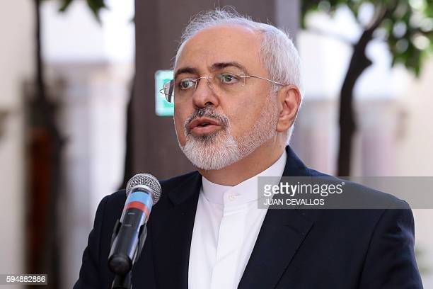 Iran's Foreign Minister Mohammad Javad Zarif speaks to the press during his visit to Quito on August 24 2016 Zarif who is travelling with a large...