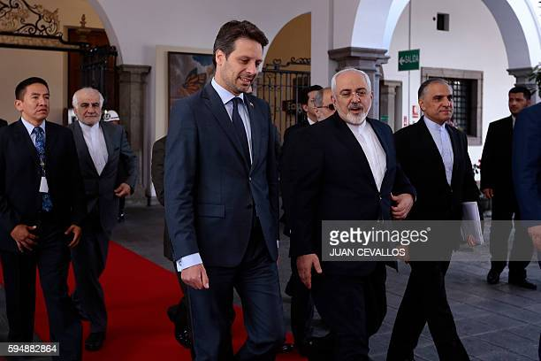 Iran's Foreign Minister Mohammad Javad Zarif talks with his Ecuadorean counterpart Guillaume Long during a meeting in Quito on August 24 2016 Zarif...