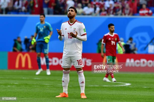 Iran's forward Alireza Jahanbakhsh prays prior to the Russia 2018 World Cup Group B football match between Morocco and Iran at the Saint Petersburg...