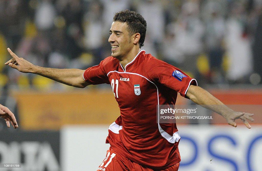 Iran's forward Arash Afshin celebrates after he scored a goal ...