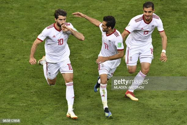 TOPSHOT Iran's forward Karim Ansari Fard celebrates scoring a penalty with his teammates during the Russia 2018 World Cup Group B football match...