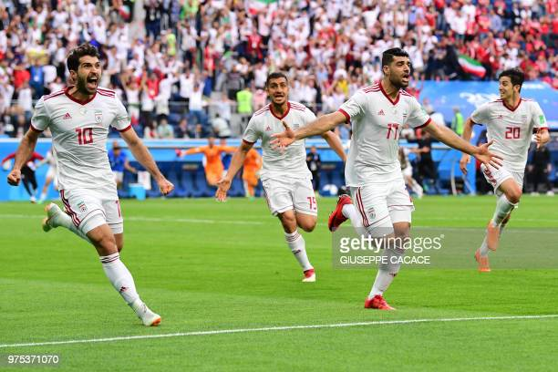 Iran's forward Karim Ansari Fard Iran's defender Pejman Montazeri Iran's forward Mehdi Taremi Iran's forward Sardar Azmoun react after Morocco scored...