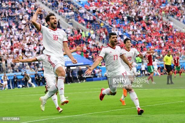 Iran's forward Karim Ansari Fard Iran's forward Mehdi Taremi and Iran's forward Sardar Azmoun reacts after Morocco scored an own goal during the...