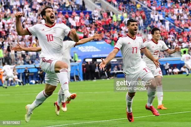 TOPSHOT Iran's forward Karim Ansari Fard Iran's forward Mehdi Taremi and Iran's forward Sardar Azmoun reacts after Morocco scored an own goal during...