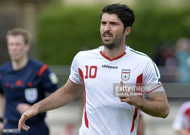 Iran's forward Karim Ansarifard reacts during the friendly football match Iran vs Belarus in preparation for the FIFA World Cup 2014 on May 18 2014...