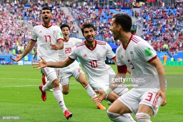 Iran's forward Mehdi Taremi Iran's forward Sardar Azmoun Iran's forward Karim Ansari Fard and Iran's midfielder Ehsan Haji Safi reacts after Morocco...