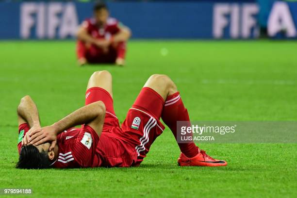 Iran's forward Mehdi Taremi reacts after defeat during the Russia 2018 World Cup Group B football match between Iran and Spain at the Kazan Arena in...