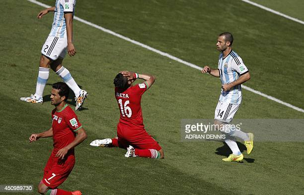 Iran's forward Reza Ghoochannejhad reacts during the Group F football match between Argentina and Iran at the Mineirao Stadium in Belo Horizonte...