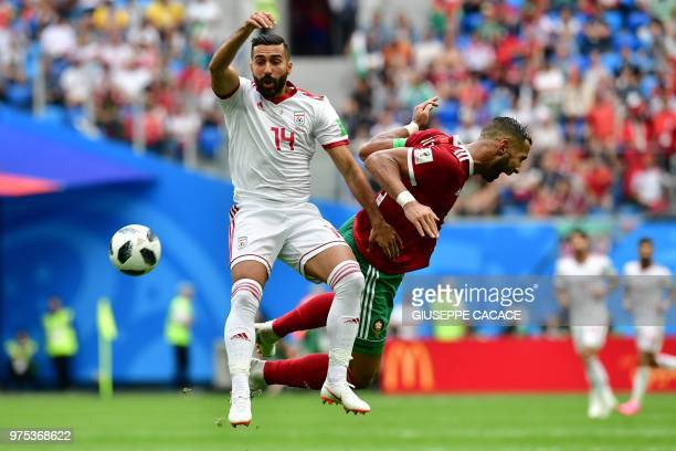 Iran's forward Saman Ghoddos vies for the ball with Morocco's defender Mehdi Benatia during the Russia 2018 World Cup Group B football match between...