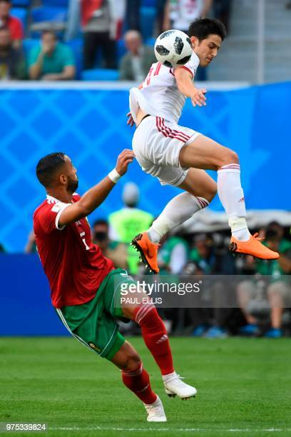 Iran's forward Sardar Azmoun and Morocco's defender Mehdi Benatia vie during the Russia 2018 World Cup Group B football match between Morocco and...