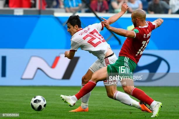 Iran's forward Sardar Azmoun and Morocco's forward Noureddine Amrabat vie during the Russia 2018 World Cup Group B football match between Morocco and...