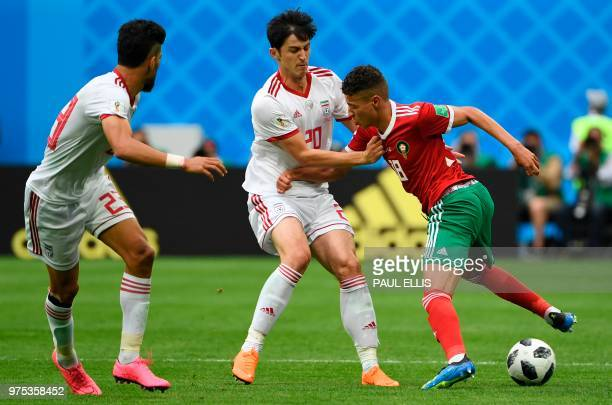 Iran's forward Sardar Azmoun and Morocco's midfielder Amine Harit vie during the Russia 2018 World Cup Group B football match between Morocco and...