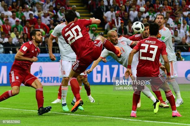 Iran's forward Sardar Azmoun and Spain's forward David Silva compete for the ball during the Russia 2018 World Cup Group B football match between...