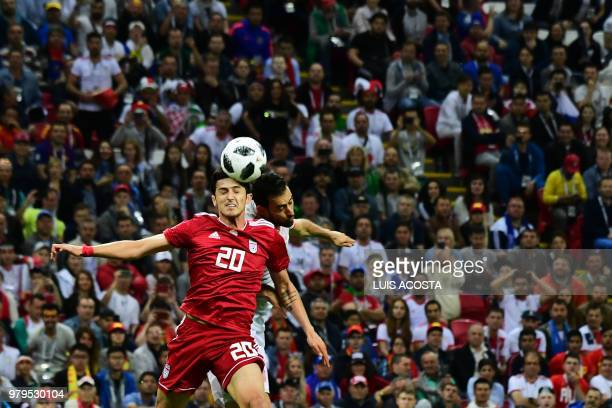 Iran's forward Sardar Azmoun and Spain's midfielder Sergio Busquets compete for the ball during the Russia 2018 World Cup Group B football match...