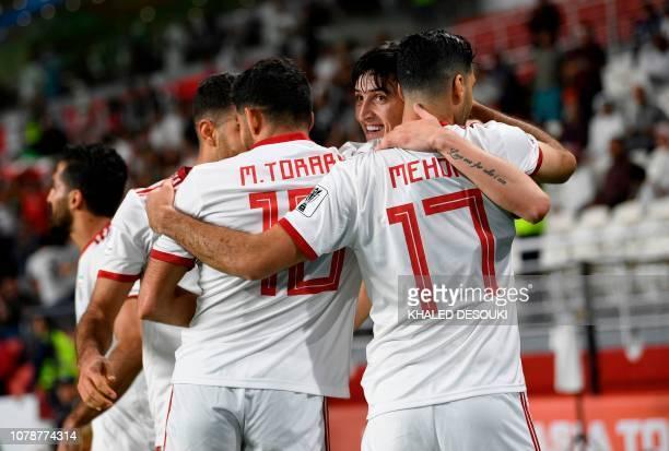 TOPSHOT Iran's forward Sardar Azmoun celebrates after scoring a goal during the 2019 AFC Asian Cup Group D football match between Yemen and Iran at...