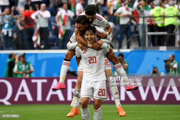 Iran's forward Sardar Azmoun celebrates with teammates at the end of the Russia 2018 World Cup Group B football match between Morocco and Iran at the...