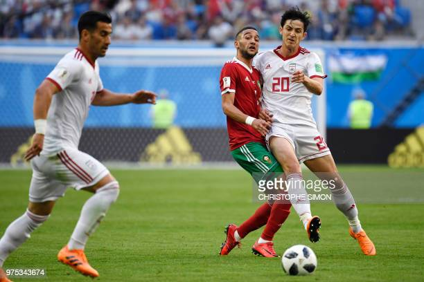 Iran's forward Sardar Azmoun challenges Morocco's midfielder Hakim Ziyech during the Russia 2018 World Cup Group B football match between Morocco and...
