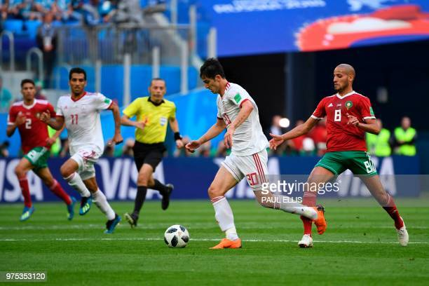 Iran's forward Sardar Azmoun controls the ball during the Russia 2018 World Cup Group B football match between Morocco and Iran at the Saint...