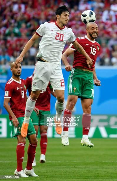 Iran's forward Sardar Azmoun heads the ball with Morocco's forward Noureddine Amrabat during the Russia 2018 World Cup Group B football match between...
