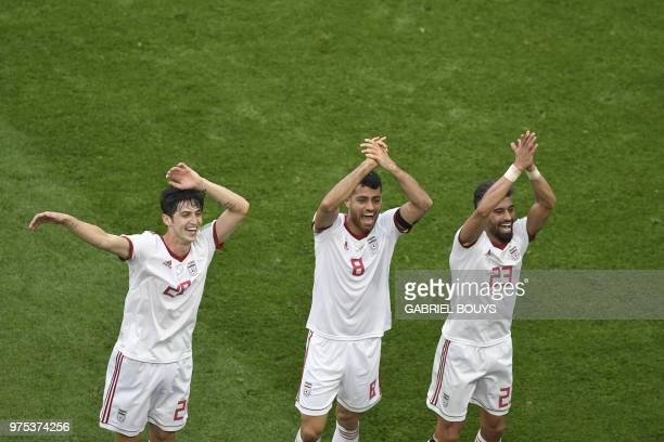 Iran's forward Sardar Azmoun Iran's defender Morteza Pouraliganji and Iran's defender Ramin Rezaian celebrate after winning the Russia 2018 World Cup...
