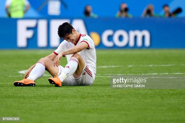 Iran's forward Sardar Azmoun reacts after falling during the Russia 2018 World Cup Group B football match between Morocco and Iran at the Saint...