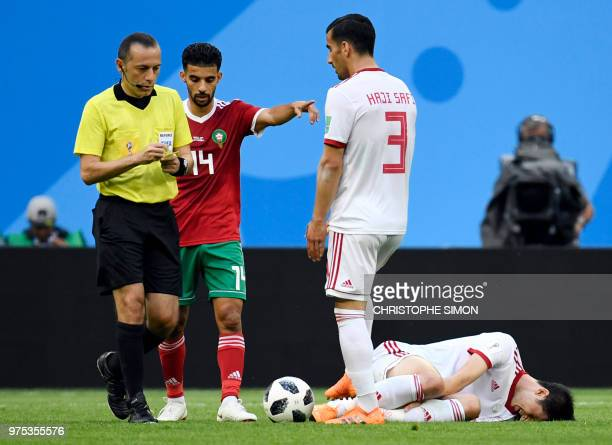 Iran's forward Sardar Azmoun reacts after falling following a foul during the Russia 2018 World Cup Group B football match between Morocco and Iran...