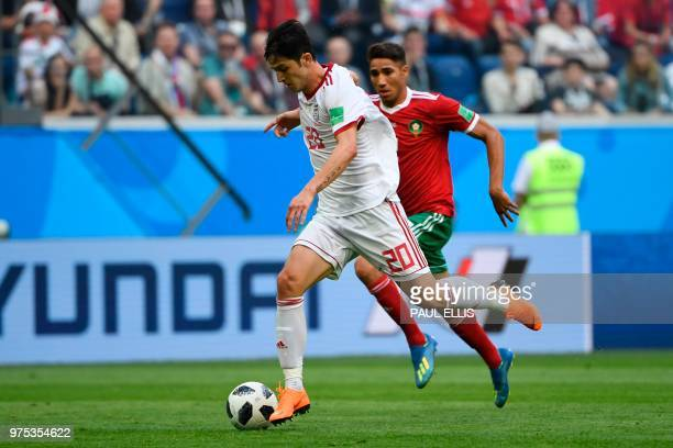 Iran's forward Sardar Azmoun runs with the ball during the Russia 2018 World Cup Group B football match between Morocco and Iran at the Saint...