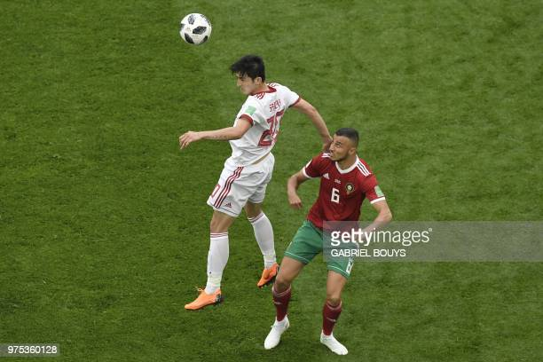 Iran's forward Sardar Azmoun vies for the ball with Morocco's defender Romain Saiss during the Russia 2018 World Cup Group B football match between...