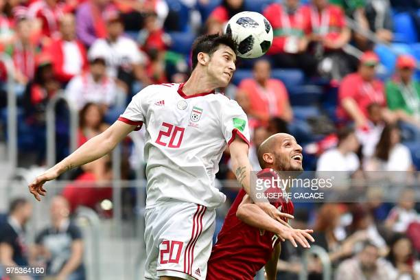 Iran's forward Sardar Azmoun vies for the ball with Morocco's forward Ayoub Kaabi during the Russia 2018 World Cup Group B football match between...