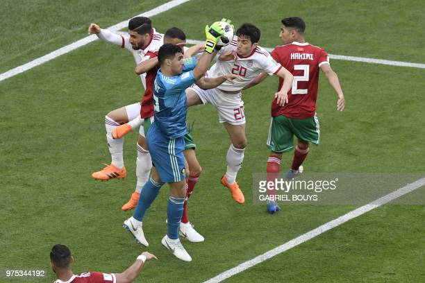 Iran's forward Sardar Azmoun vies for the ball with Morocco's goalkeeper Munir Mohand Mohamedi during the Russia 2018 World Cup Group B football...