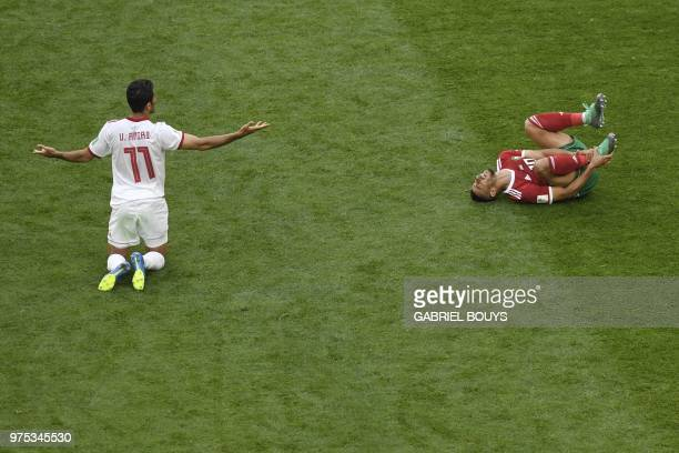 TOPSHOT Iran's forward Vahid Amiri reacts next to Morocco's midfielder Younes Belhanda during the Russia 2018 World Cup Group B football match...