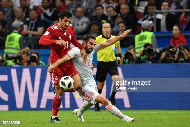 Iran's forward Vahid Amiri vies for the ball with Spain's defender Dani Carvajal during the Russia 2018 World Cup Group B football match between Iran...