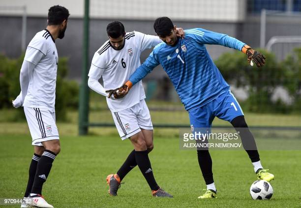Iran's goalkeeper Ali Beiranvand and midfielder Saeid Ezatolahi attend a training session in Bakovka outside Moscow on June 10 ahead of the Russia...