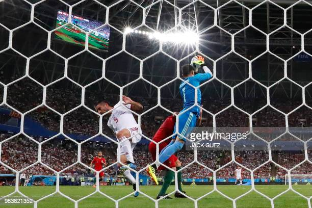 Iran's goalkeeper Alireza Beiranvand jumps to catch the ball during the Russia 2018 World Cup Group B football match between Iran and Portugal at the...