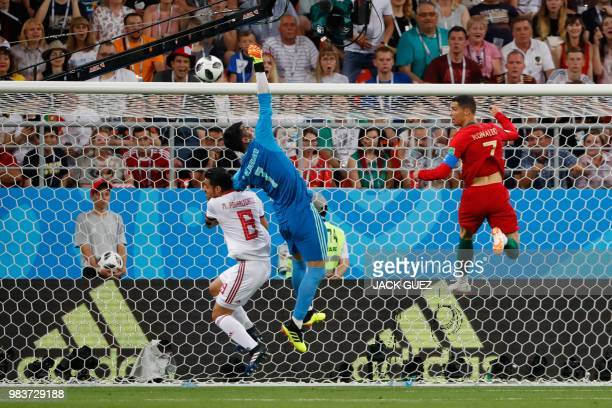 TOPSHOT Iran's goalkeeper Alireza Beiranvand jumps to save a shot during the Russia 2018 World Cup Group B football match between Iran and Portugal...