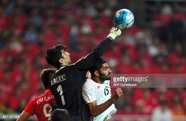 Iran's goalkeeper Alireza Beiranvand punches the ball against South Korea during the FIFA 2018 World Cup qualifying football match in Seoul on August...