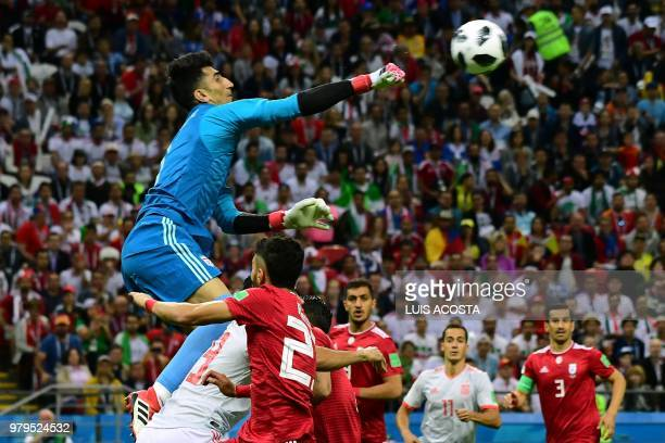 TOPSHOT Iran's goalkeeper Alireza Beiranvand punches the ball away during the Russia 2018 World Cup Group B football match between Iran and Spain at...