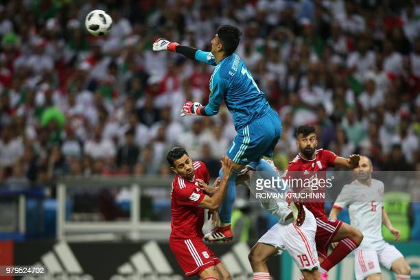 Iran's goalkeeper Alireza Beiranvand punches the ball away during the Russia 2018 World Cup Group B football match between Iran and Spain at the...