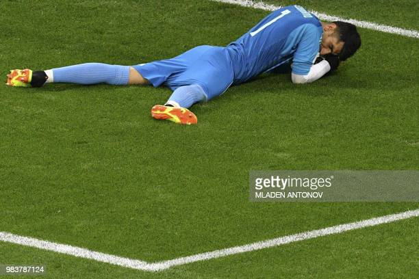 TOPSHOT Iran's goalkeeper Alireza Beiranvand saves Portugal's forward Cristiano Ronaldo's penalty during the Russia 2018 World Cup Group B football...
